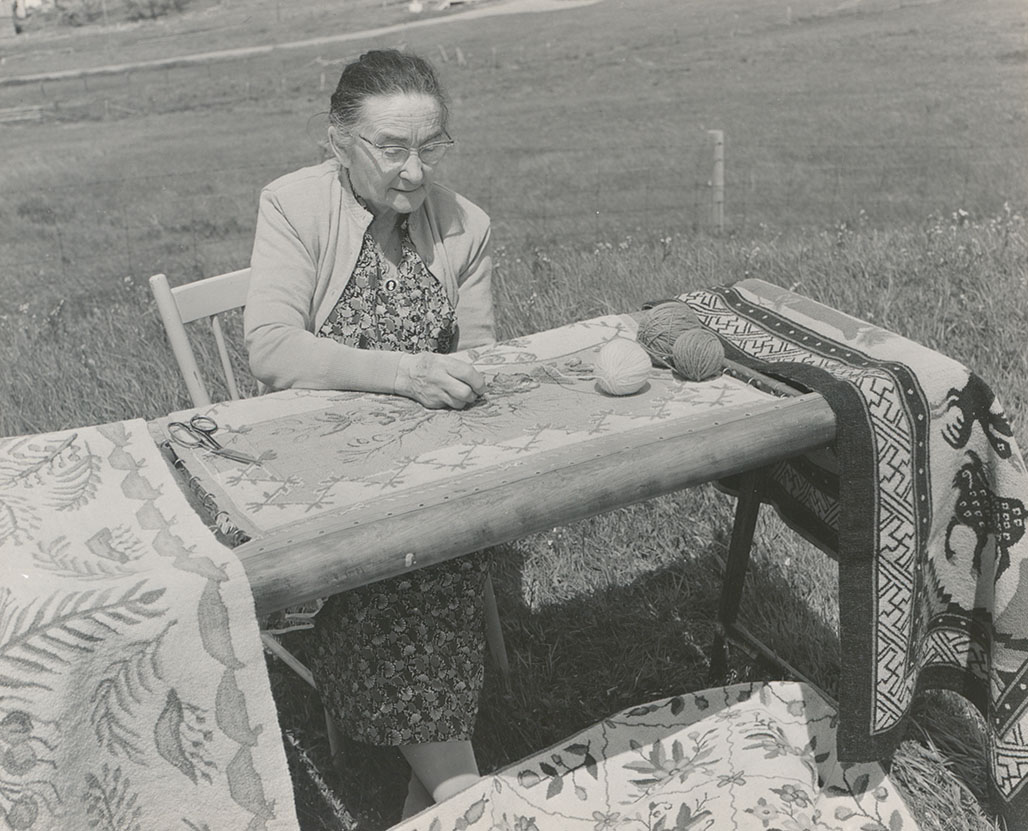 Hooking famous Cheticamp rug