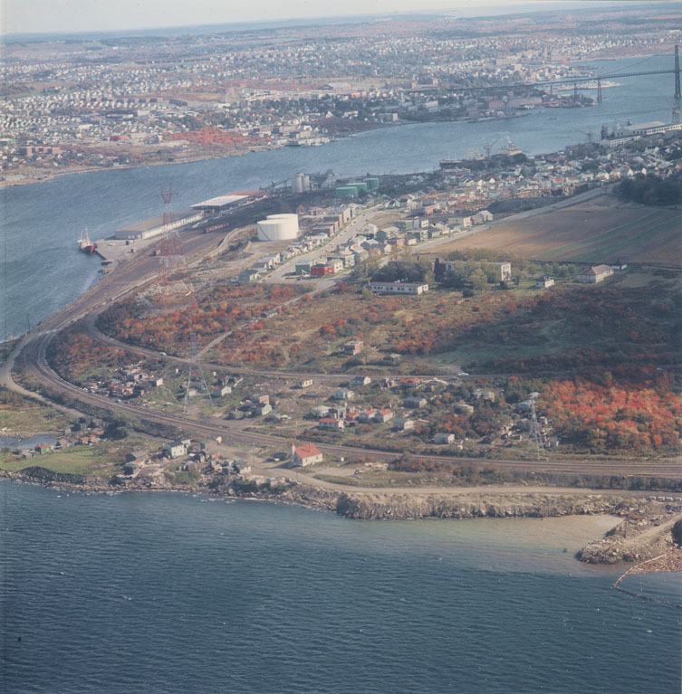 Bird's eye view of Africville, showing its location on Bedford Basin, with north end Halifax and the Narrows in the background