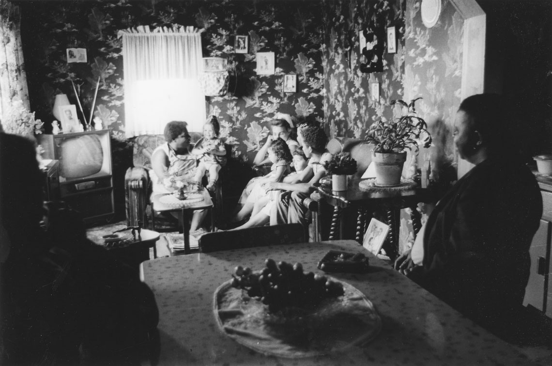Another view of a family in their living room, Africville