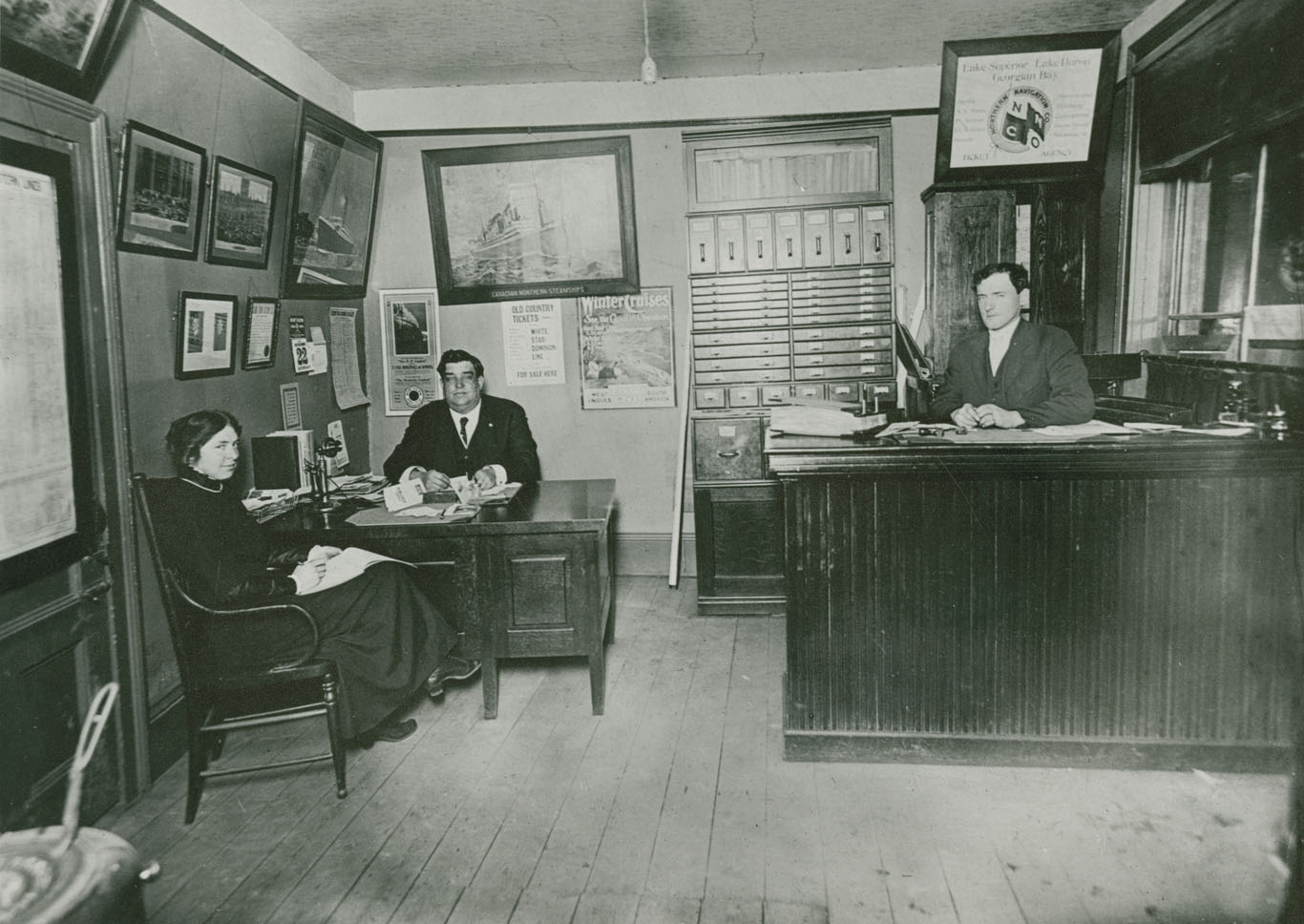 Insurance office – left to right: Ethel Martin Moreland, George J. Alexander, Gordon J. Dunbar