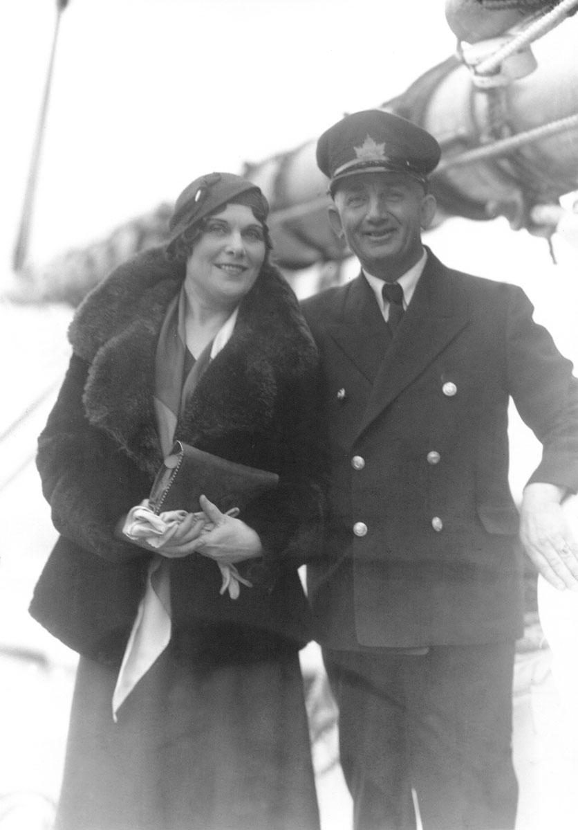 Captain Angus Walters with unidentified woman, possibly Mrs. Elva MacAskill, on board <i>Bluenose</i>