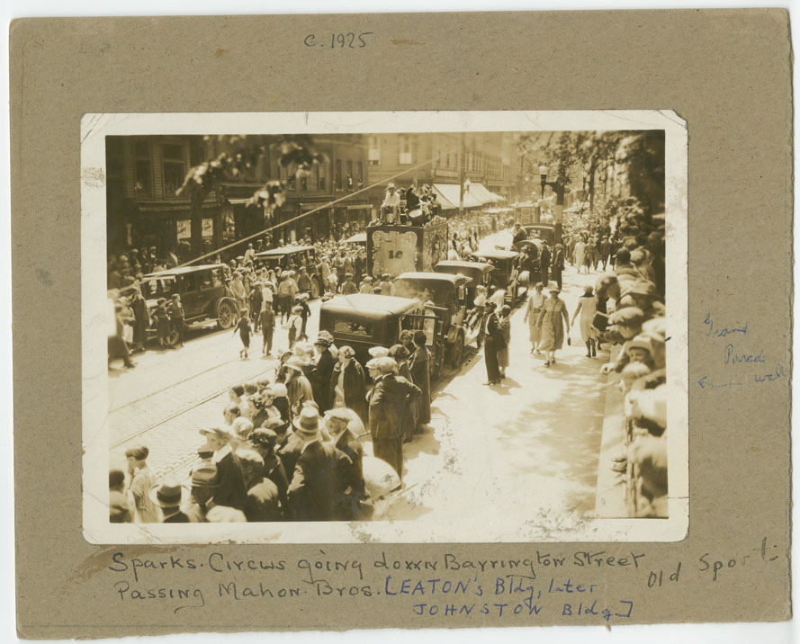 ''Sparks Circus Going Down Barrington Street Passing Mahon Bros. [Eaton's Building Later Johnston Building]''