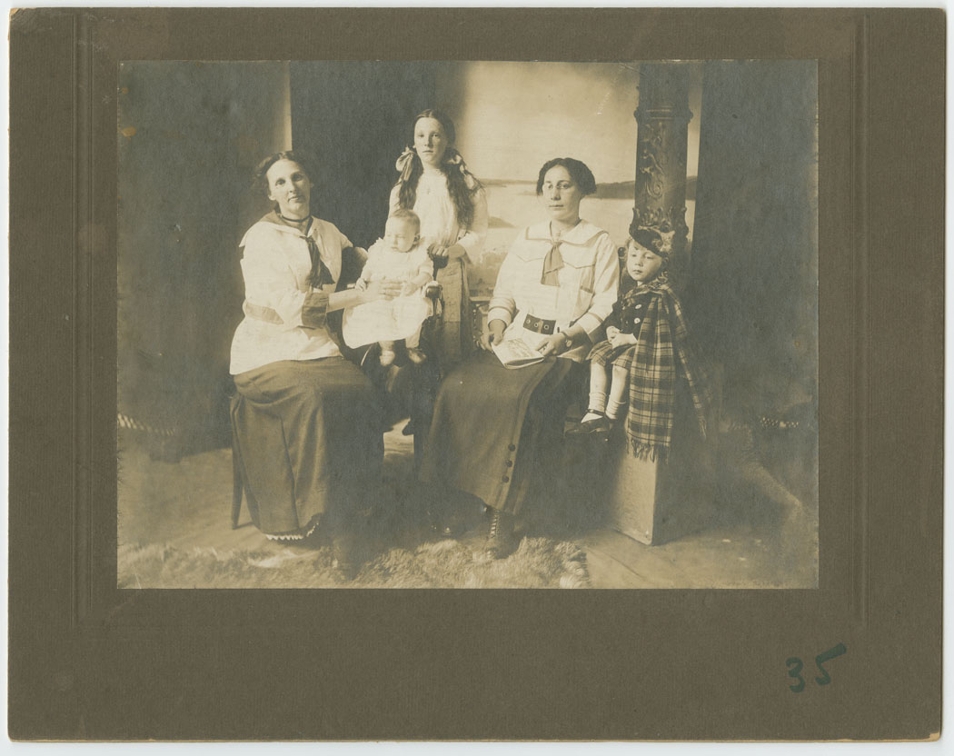 Group of Female Adults with Children in Highland Costume