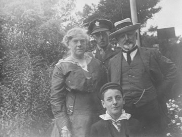 William and Agnes Dennis and two young men