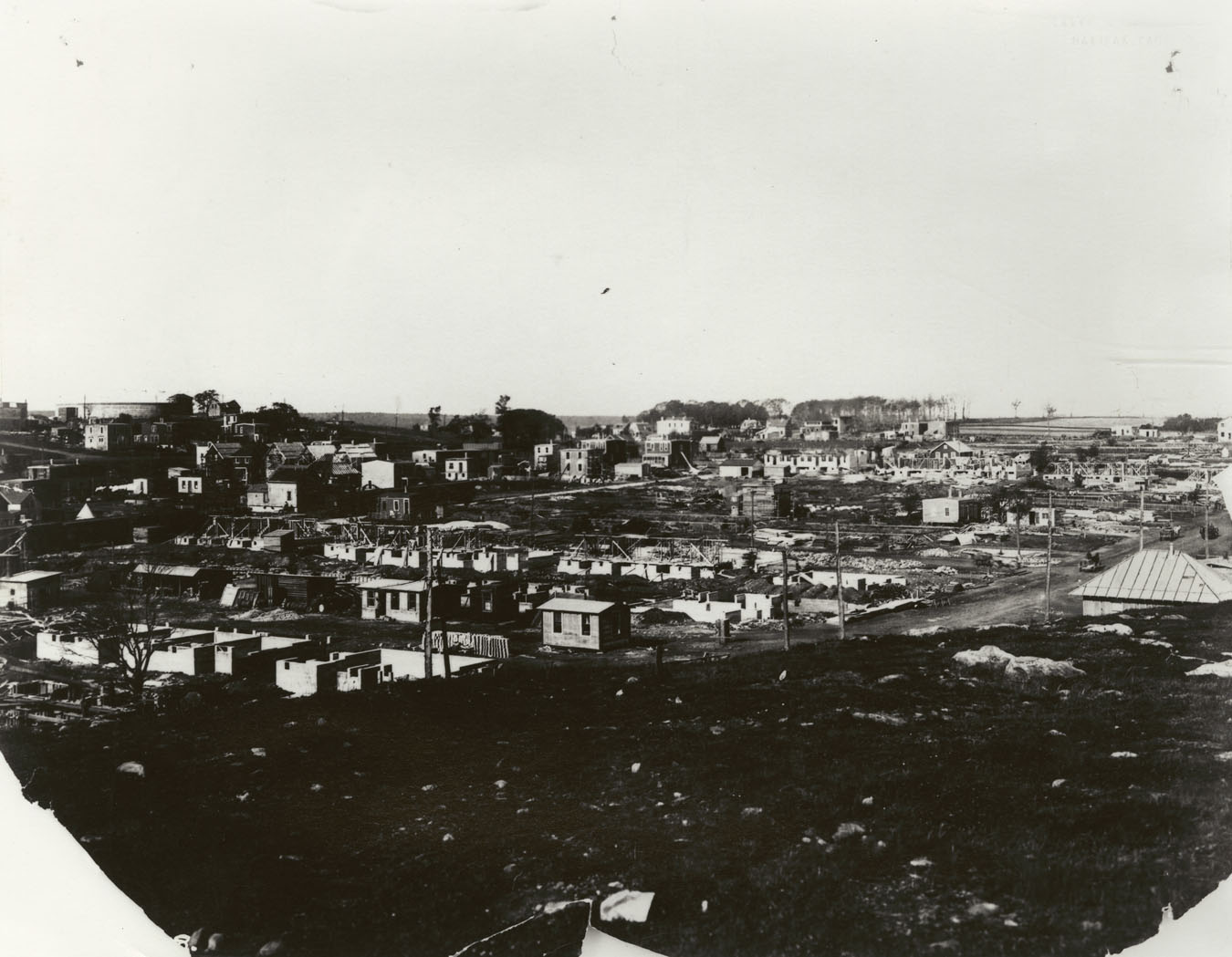 Three companion views  looking from Fort Needham towards Gottingen Street showing progress of reconstruction