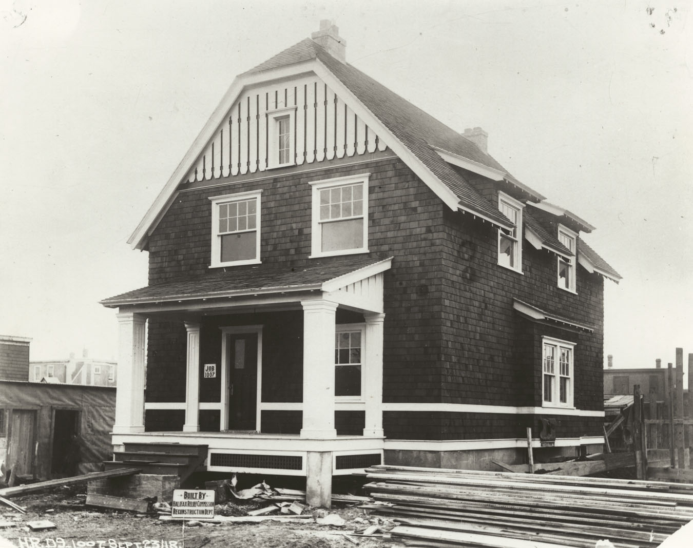 Wooden house under construction, Kane Street, Halifax, design number D.9, job 1007, built by Halifax Relief Commission, Reconstruction Department