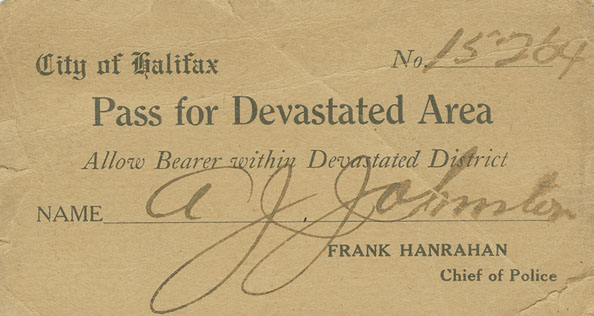 Pass for Devastated Area, number 15264, issued to A. J. Johnston.