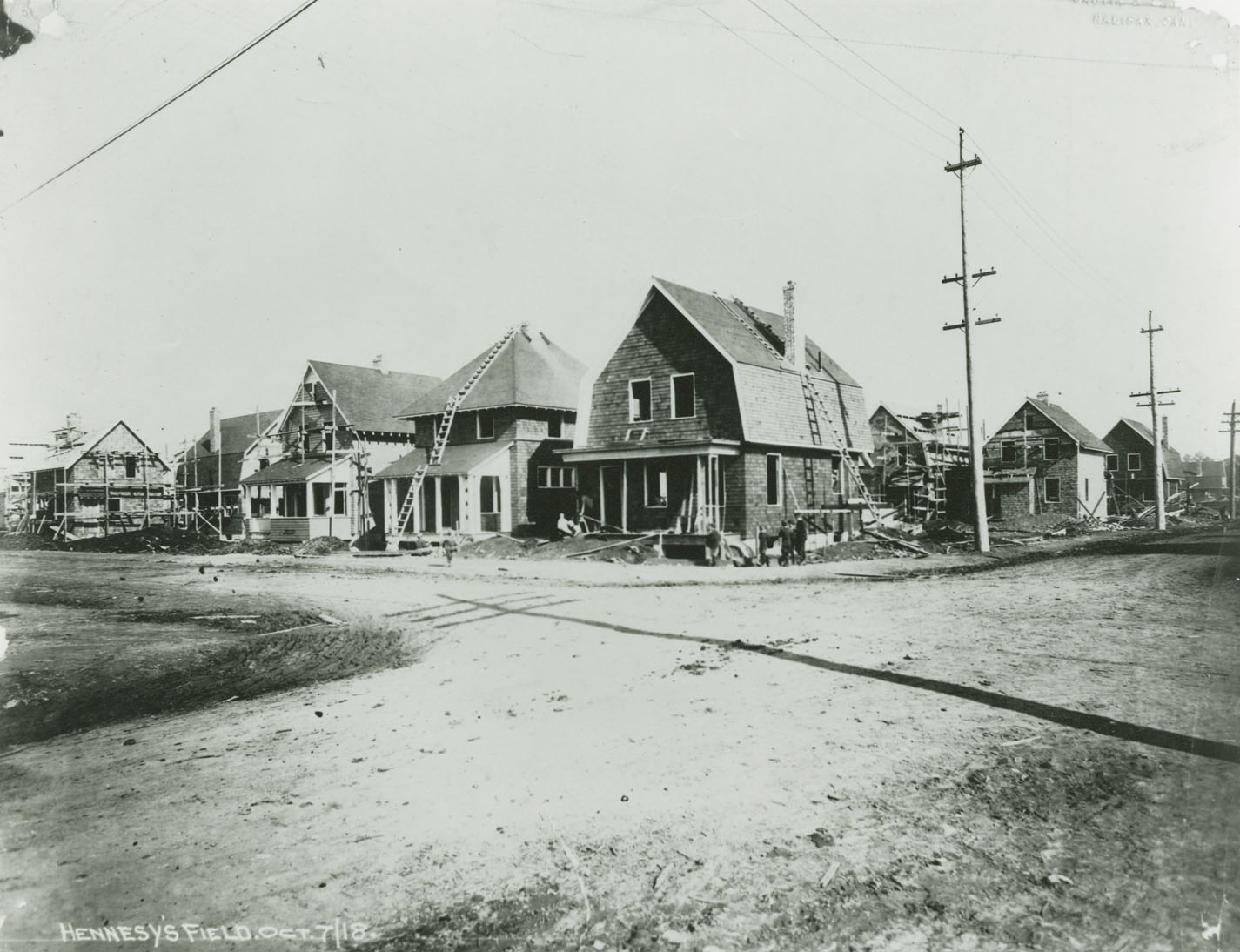 McTiernan house (on corner) and other Halifax Relief Commission houses under construction at the north-east corner of Robie and West Young streets, Halifax