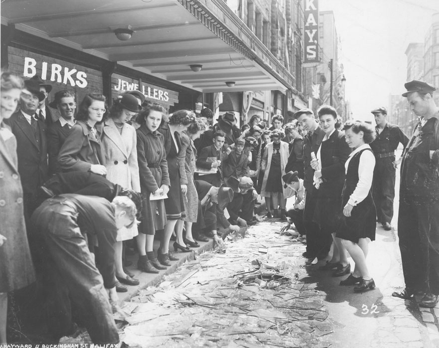 Halifax : Crowd viewing broken glass outside Henry Birks & Sons Limited, Barrington St., Halifax, after the Bedford Magazine Explosion, 18 July, 1945