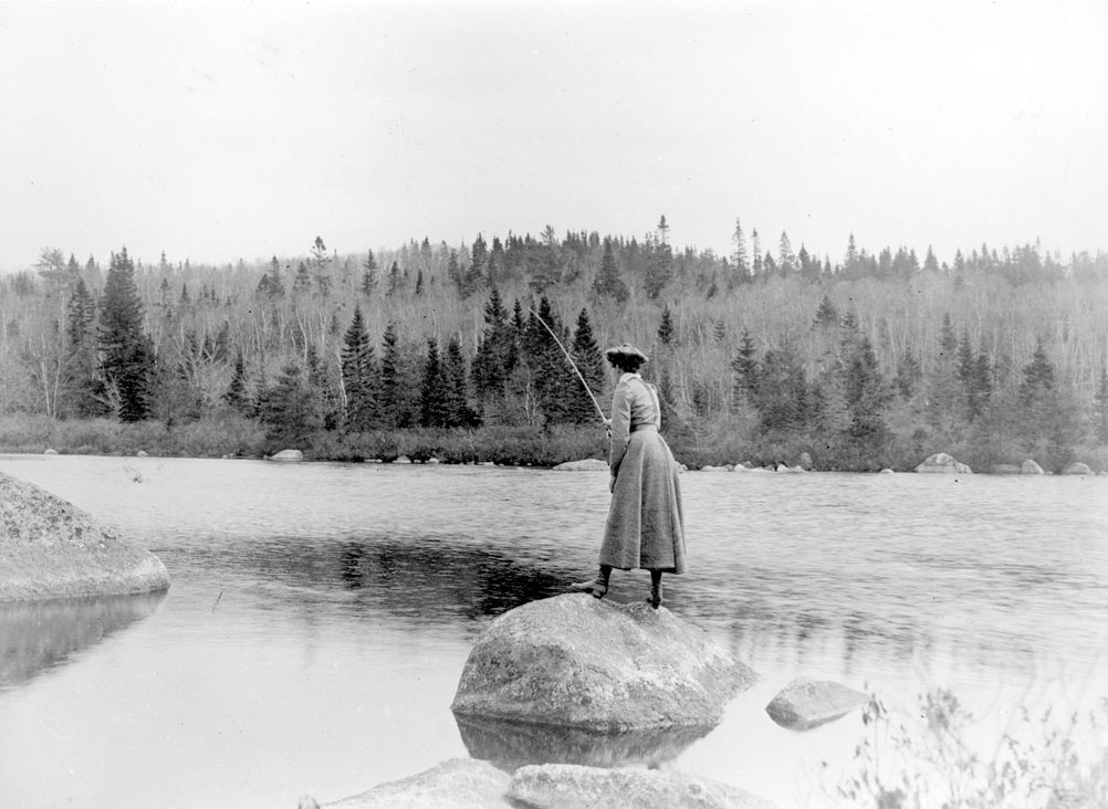 Woman fly-fishing, ca. 1900