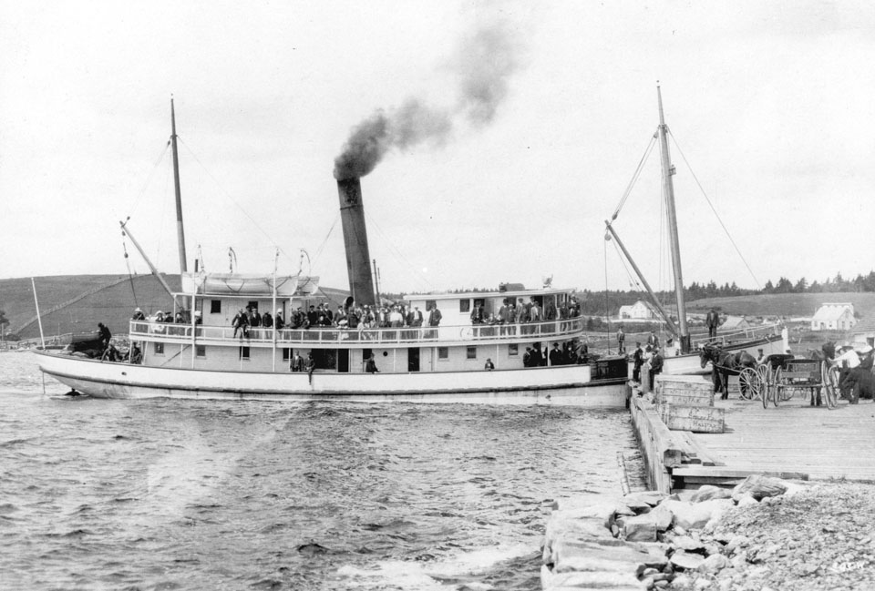 Halifax : Steamer Dufferin</i> at the Government Wharf, Port Dufferin, with Smiley & Companys Lobster Crates awaiting Transport to Halifax, ca. 1910
