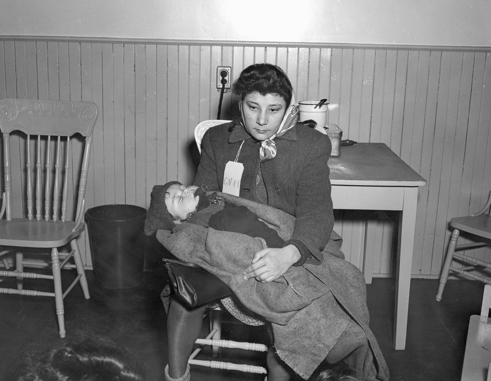 Immigrant Woman with Baby, Pier 21, Halifax, 1948
