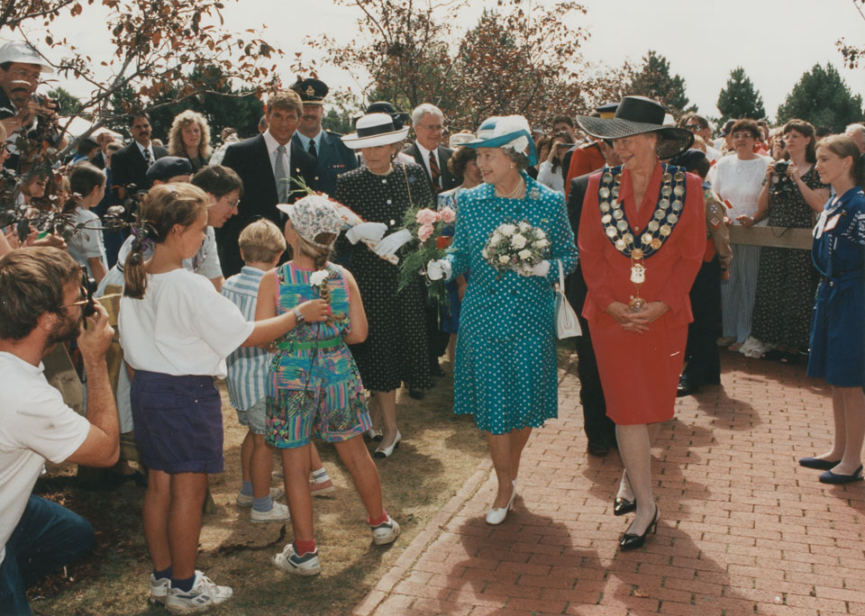 Queen Elizabeth and Ms. Gloria McCluskey,  Mayor of Dartmouth, lead a walkabout in Dartmouth