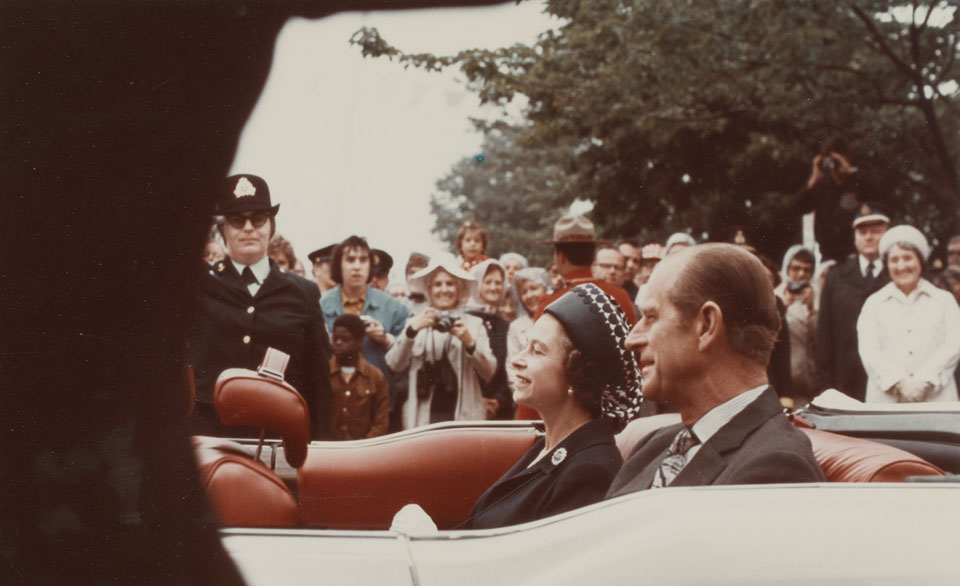 Queen Elizabeth and Prince Philip in motorcade travelling to the Grand Parade and City Hall, Halifax
