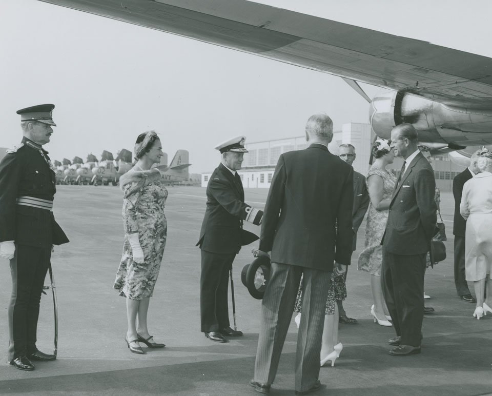 Queen Elizabeth greeting Rear Admiral H.F. Pullen with his wife and Major-General M.P. Bogert looking on