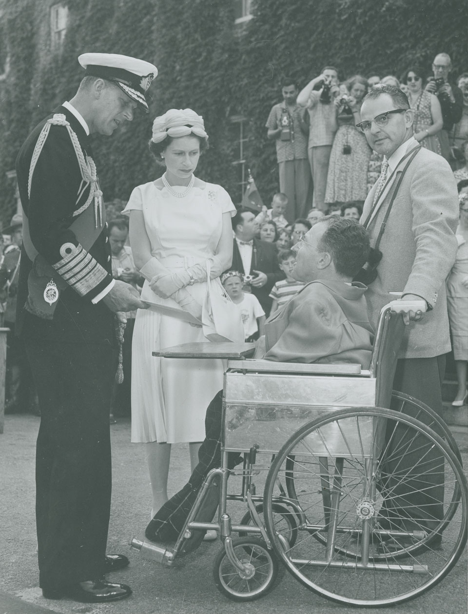 Queen Elizabeth and Prince Philip speaking with Lunenburg artist Earl Bailly at the University of King's College, Halifax