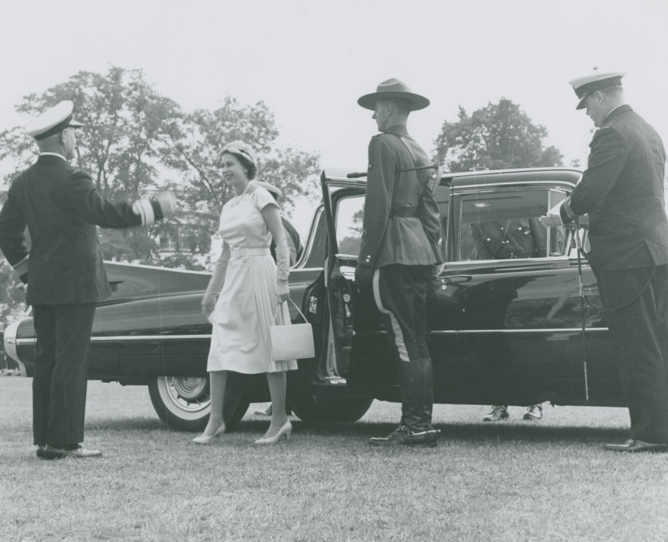 Queen Elizabeth arriving at the Garrison Grounds and greeted by Rear Admiral H.F. Pullen for presentation of new Colours to Royal Canadian Navy