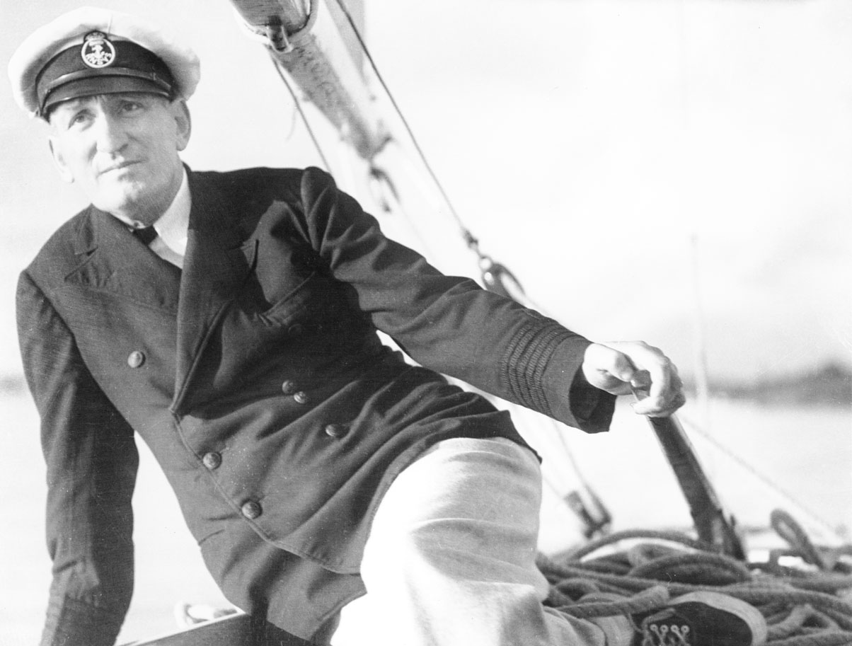 W.R. MacAskill at helm of his yacht <i>Highlander</i>