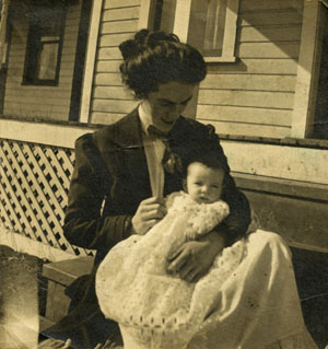 ''6 mos'', Woman holding Aileen on steps
