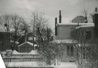 Photograph of garage and back yard