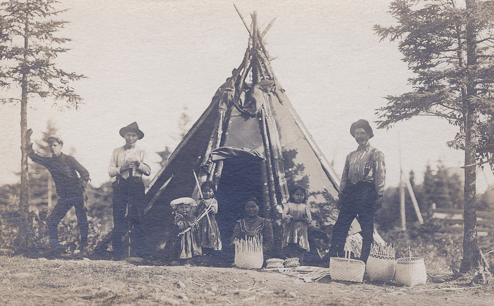 Mi'kmaq group with baskets in front of wigwam, Chester