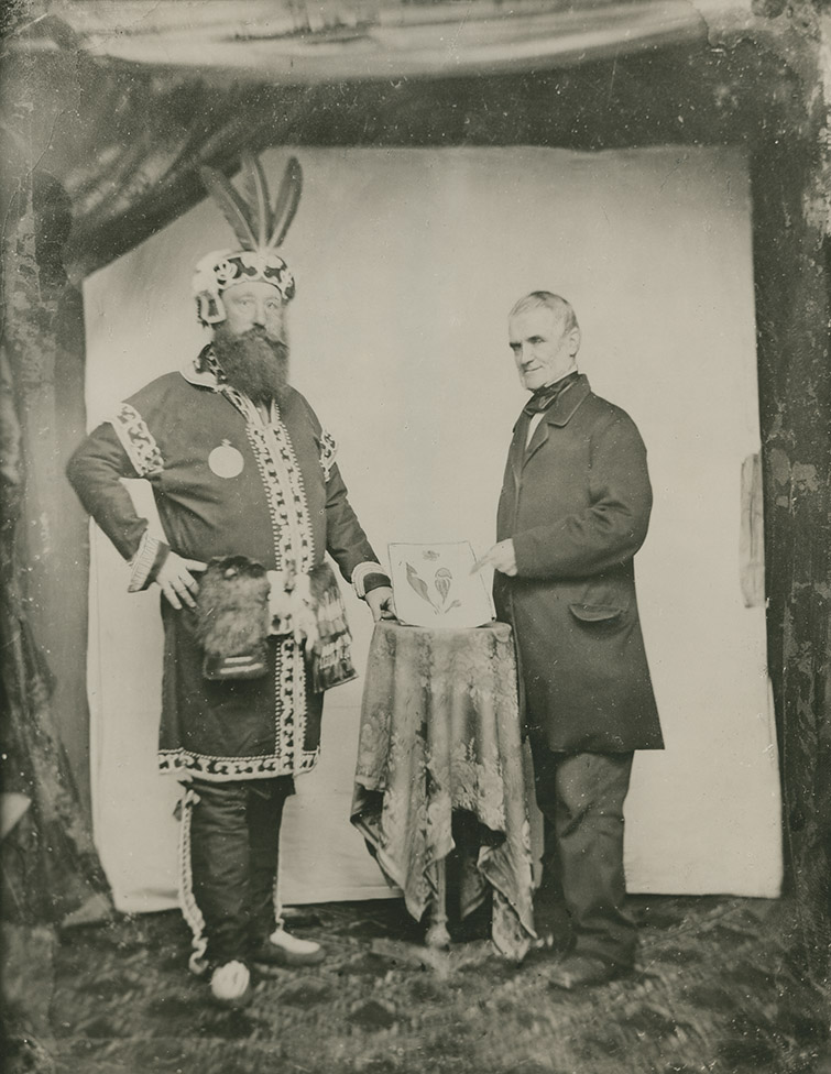 John Thomas Lane in Mi'kmaq traditional clothing and Dr. Frederick W. Morris
