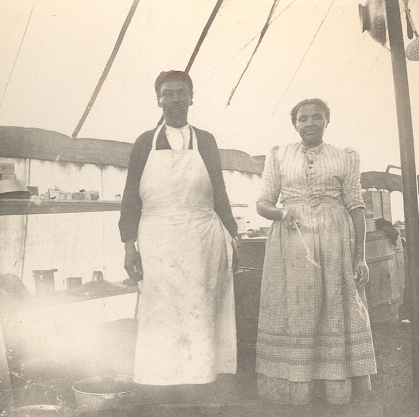 Couple posing in their cooks' aprons at the YMCA Maritime Boys Camp, Cow Bay, near Silver Sands Beach
