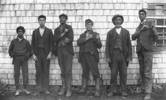 Group of men posing in front of a barn at Guysborough