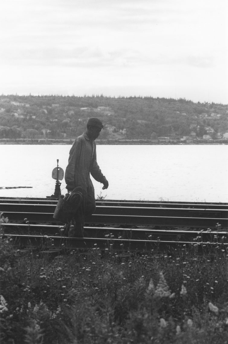 africville : Lone walker by the railroad tracks, Africville