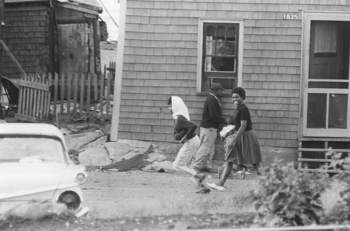 africville : Two young women walking by a house, Africville