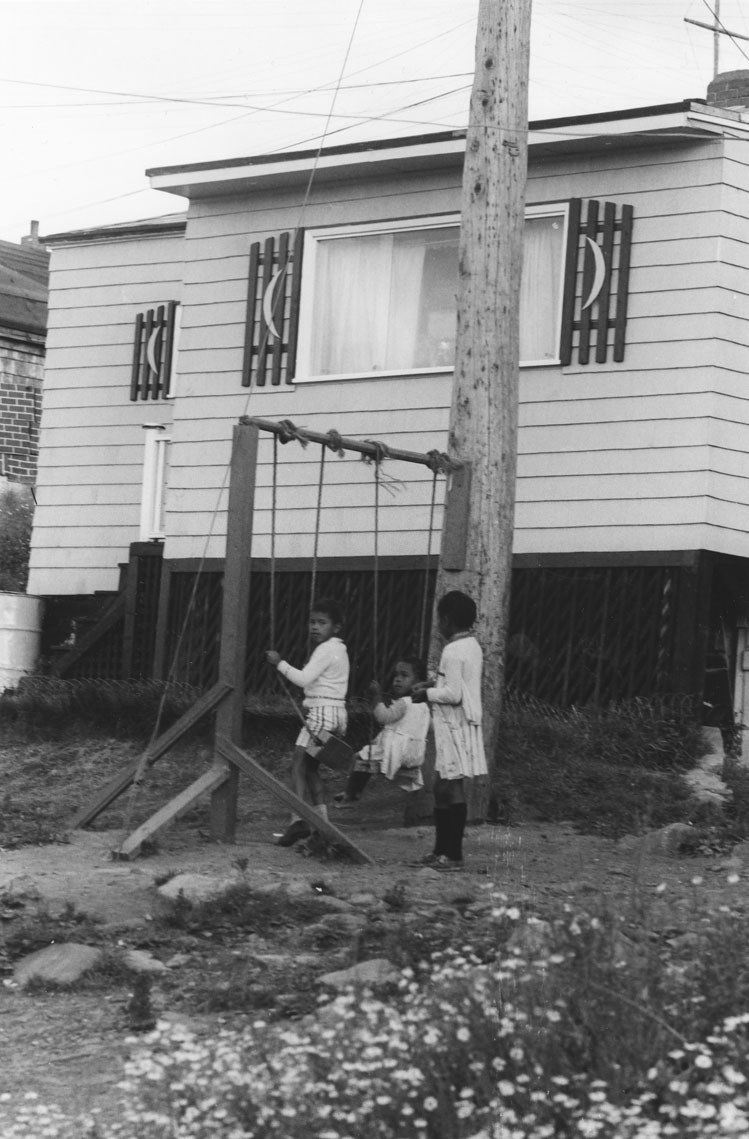 africville : Children enjoying their swing set, Africville