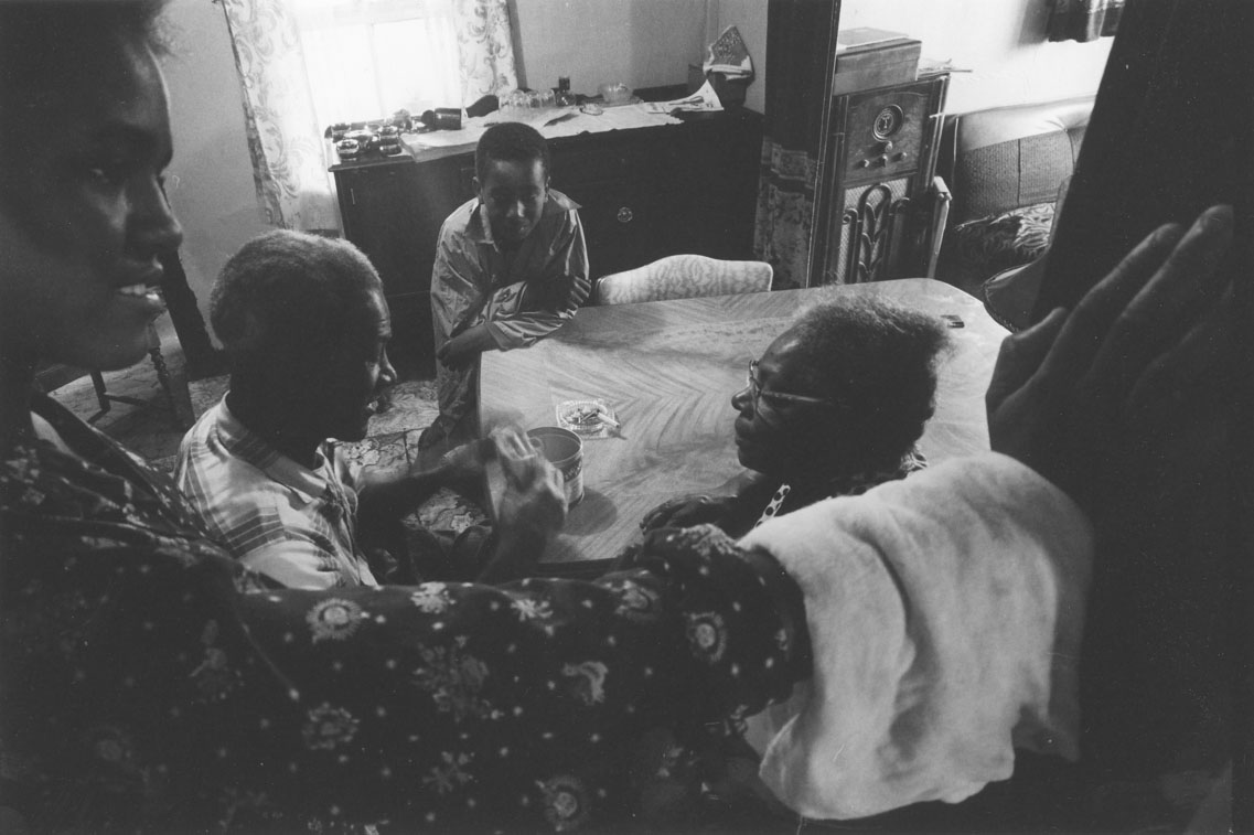africville : Another view of discussion at dining room table, Africville