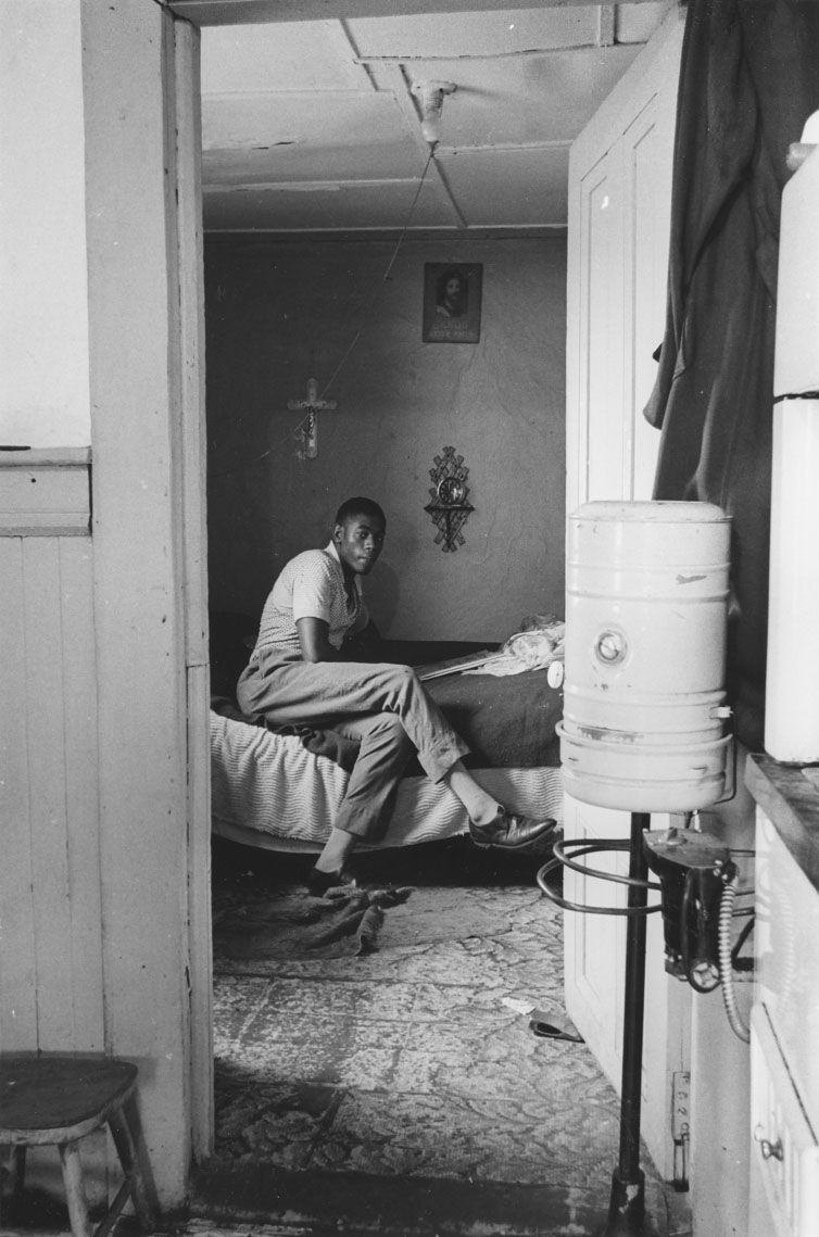 africville : Young man seated in his bedroom, Africville