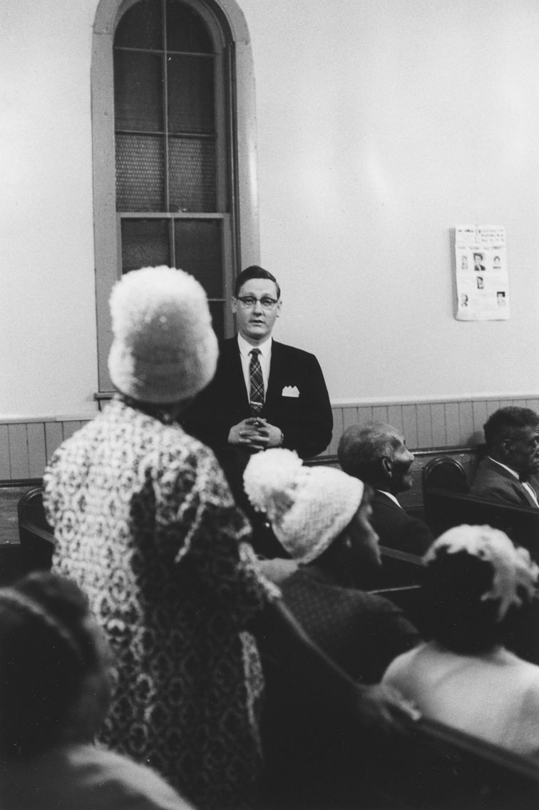 africville : Woman directing a question to a Halifax city official during a public meeting at Seaview African United Baptist Church, Africville