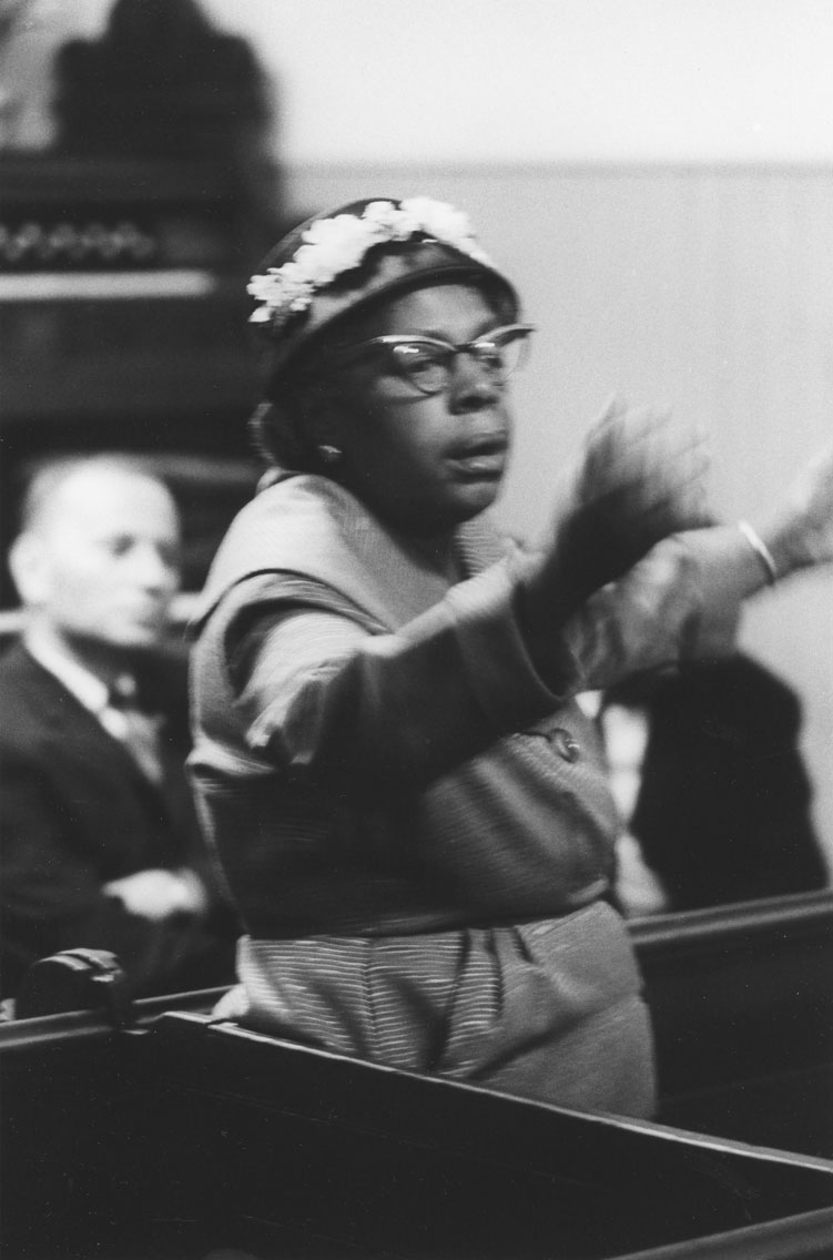 africville : Woman making a point at a public meeting at Seaview African United Baptist Church, Africville
