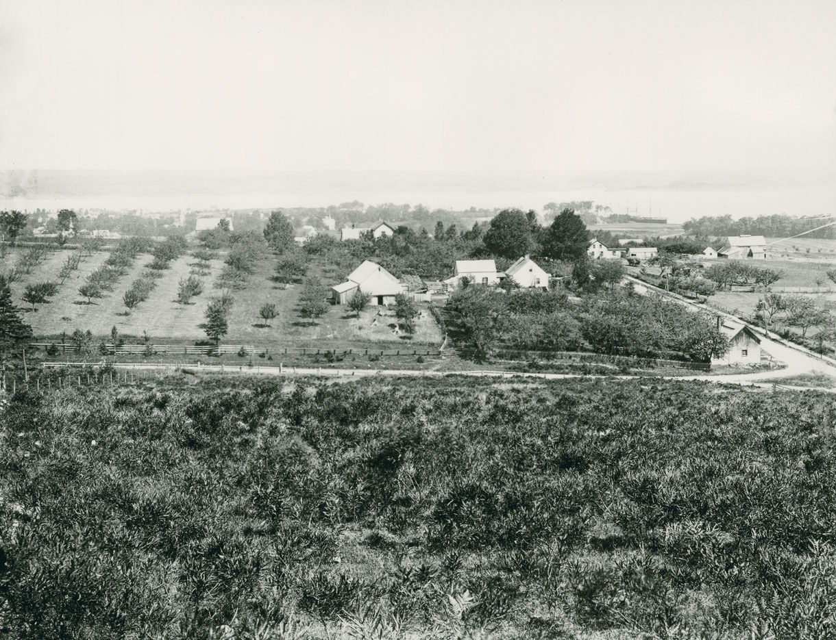 View of Avon Valley from hill showing blacksmith shop at corner of Rand and Main Streets - Hantsport, Nova Scotia