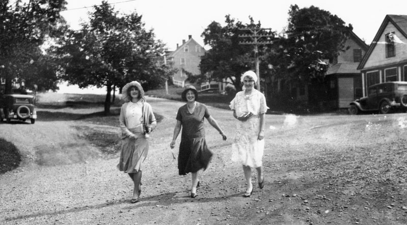 Three young women walking on the street