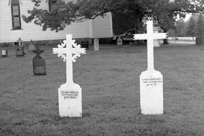 cemeteries-acadian : Pair of very ornate wooden crosses in French (see note by a member of family in Tusket Archives) — inscription in black — Simon Doucete mort
