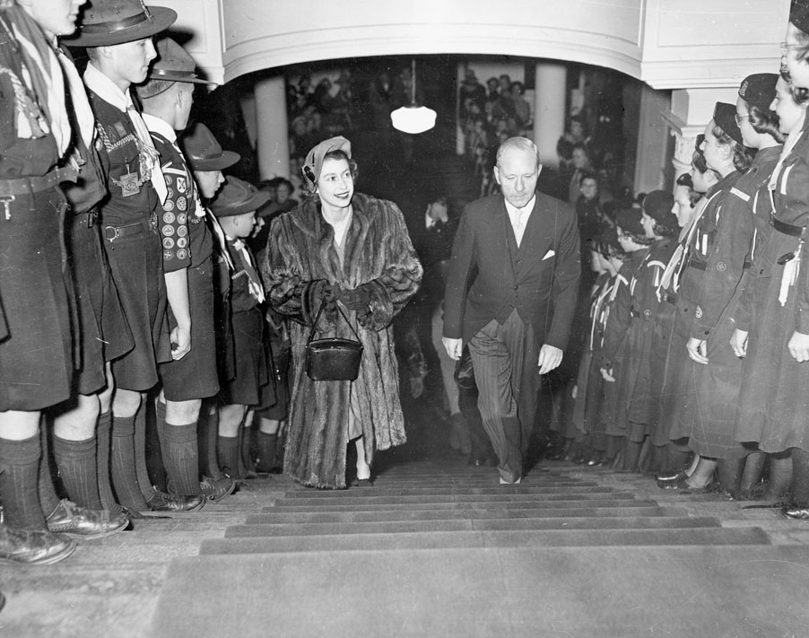 HRH Princess Elizabeth and Premier Angus L. Macdonald Walking between Boy Scouts and Girl Guides in Province House, 1951