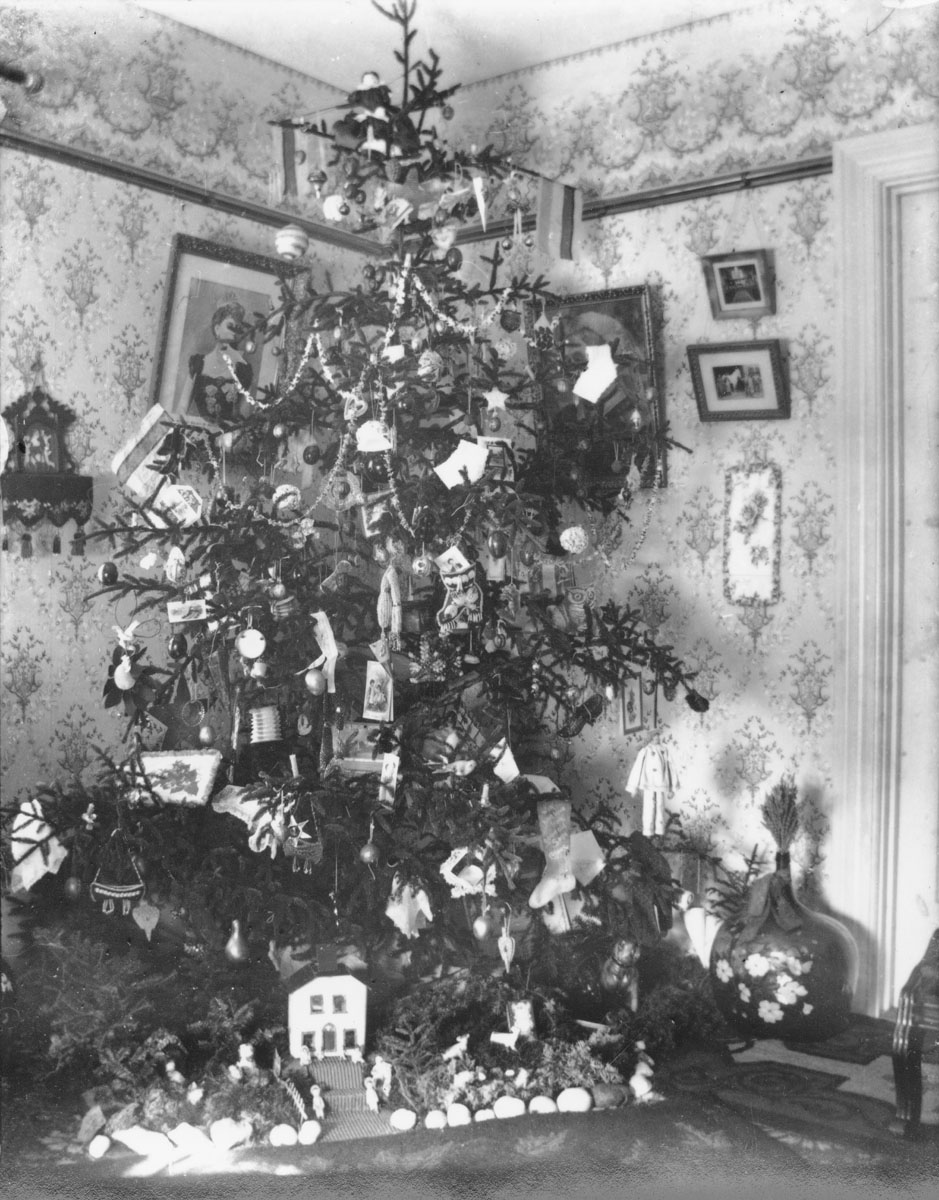 Home interior with decorated Christmas tree
