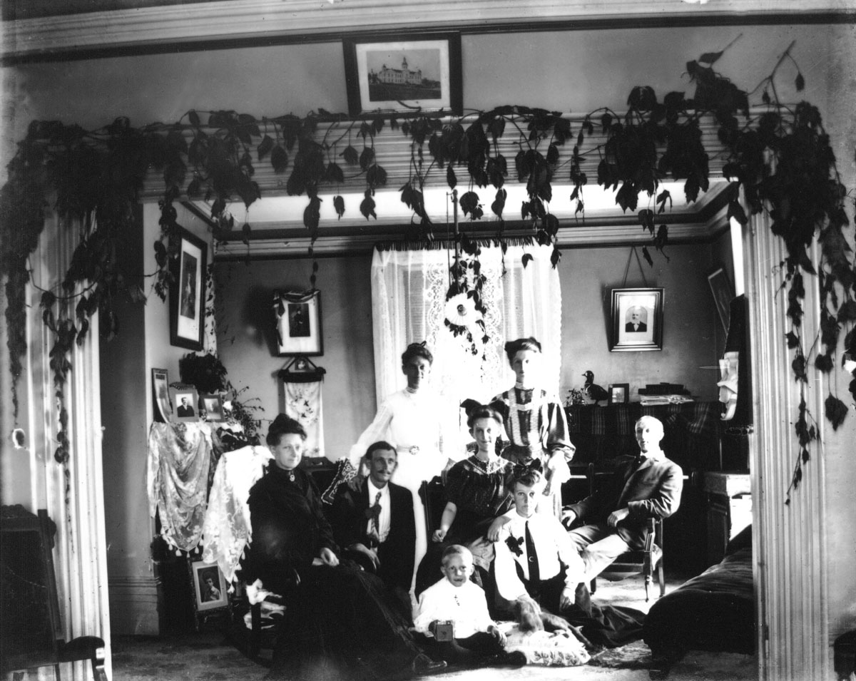Interior of parlour, with family group