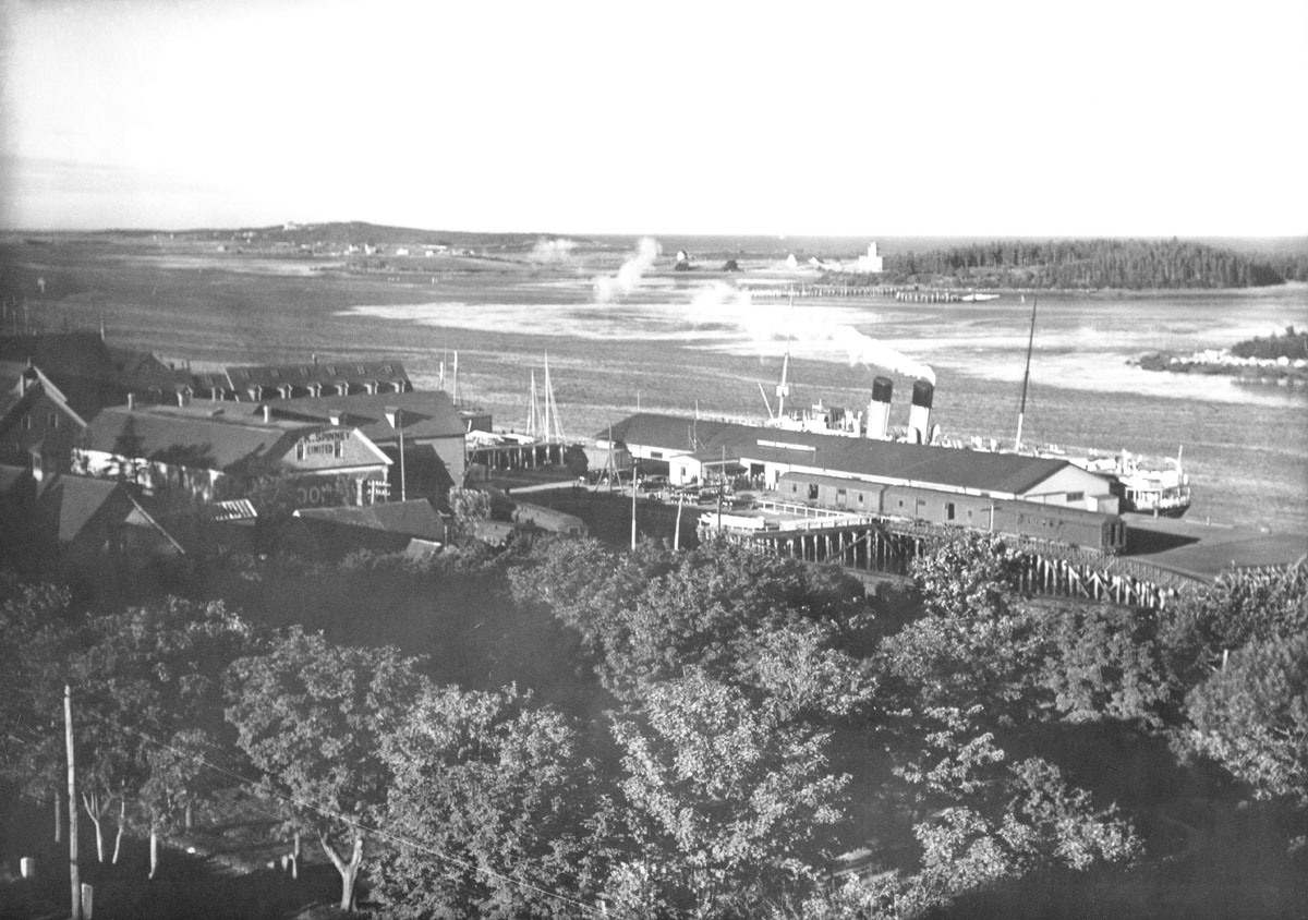 Yarmouth waterfront showing steamer docked near G.K. Spinney Ltd.
