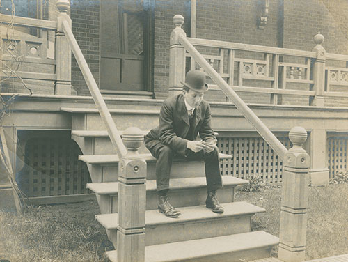 J.A.D. McCurdy sitting on steps