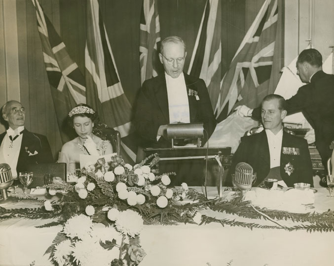 Lieutenant-Governor J.A.D. McCurdy, HRH Princess Elizabeth, Premier Angus L. Macdonald addressing attendees of a banquet in honour of the royal couple, and HRH Prince Philip