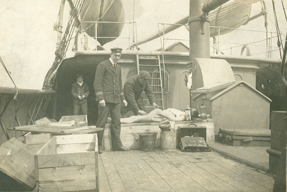 Body of RMS <i>Titanic</i> victim aboard rescue vessel CS <i>Minia</i> being made ready for make-shift coffin